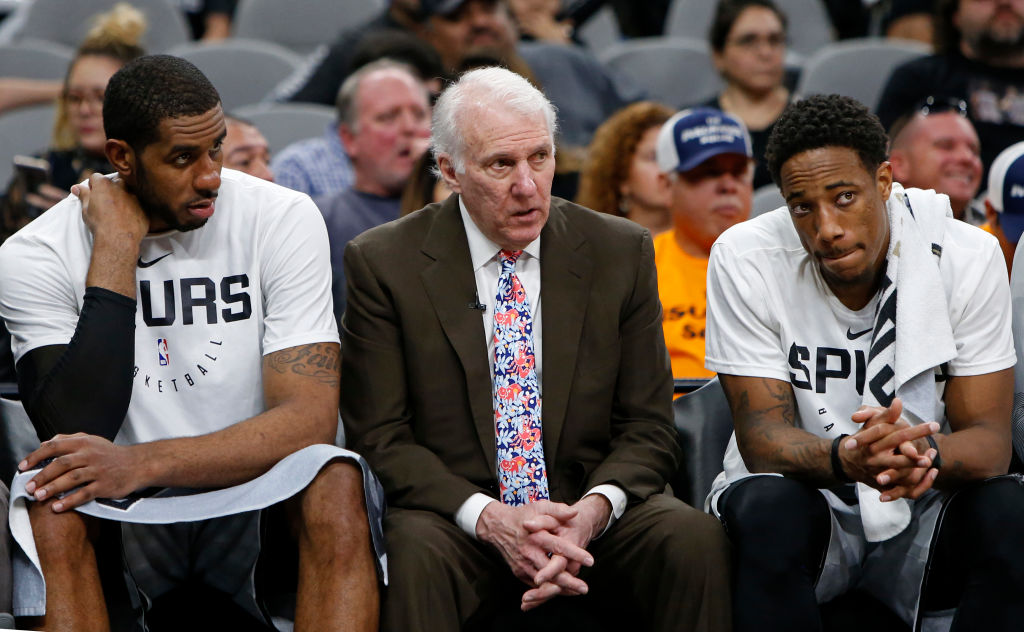 Coach Gregg Popovich (center) and the Spurs organization do a lot of things very well, according to Warriors coach Steve Kerr.