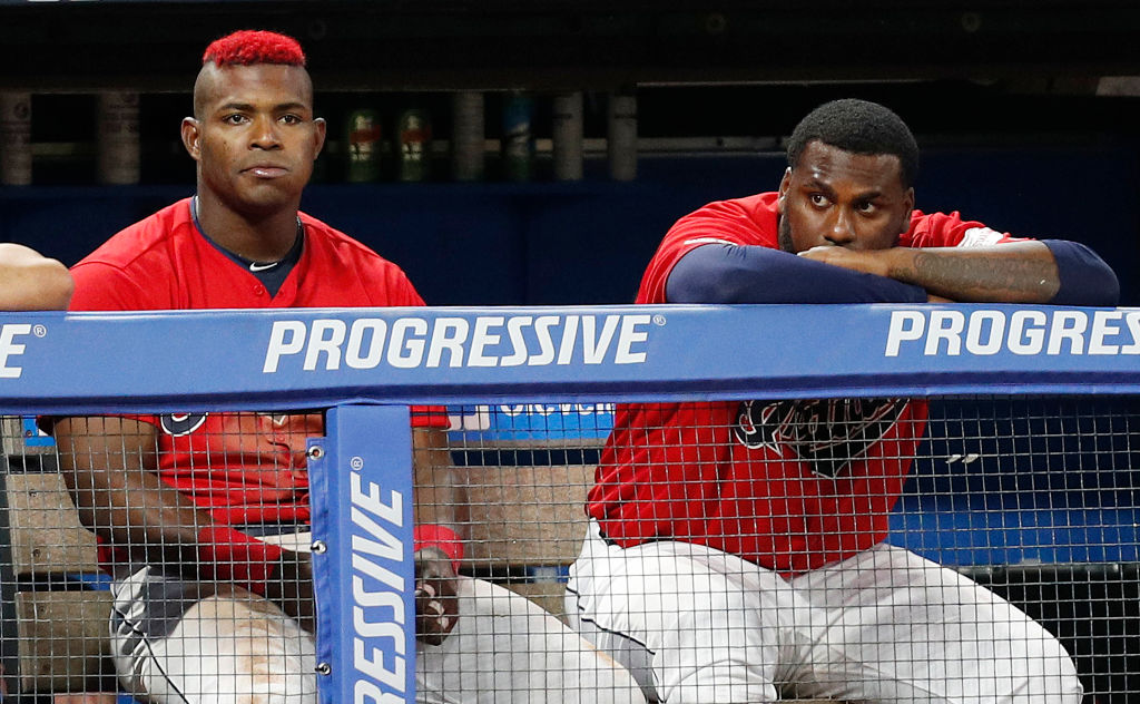 Cleveland brought in Yasiel Puig (left) and Franmil Reyes, but by adding starting pitcher Zack Greinke, Astros won the 2019 MLB trade deadline.