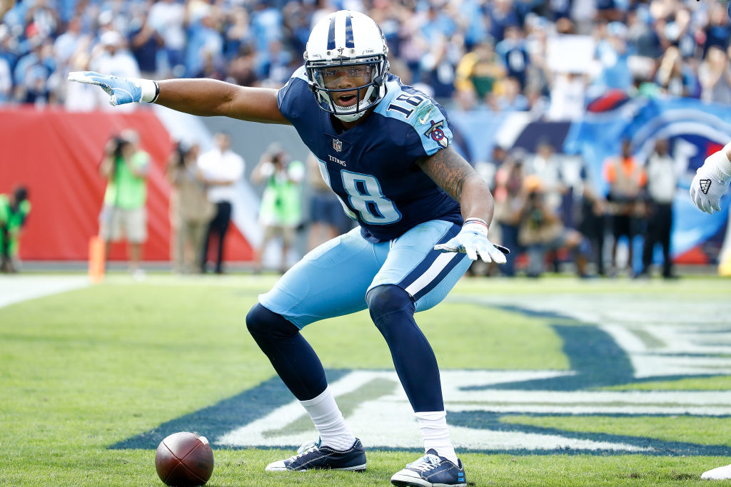 Rishard Matthews, a former wide receiver for the Tennessee Titans, celebrates after scoring a touchdown