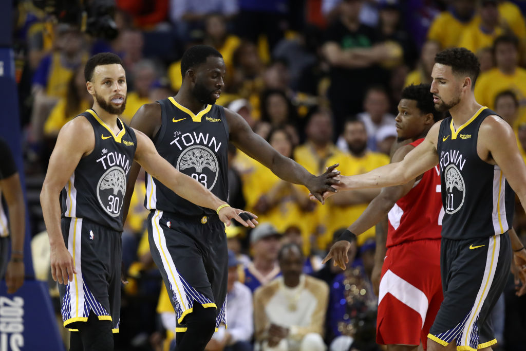 Stephen Curry (from left), Draymond Green, and Klay Thompson remain with the Warriors, but the rest of the roster changed dramatically in the 2019 offseason.