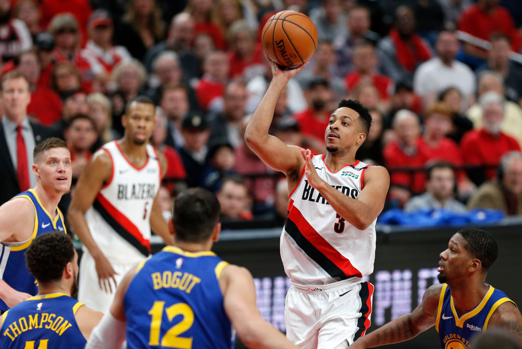 CJ McCollum (with ball) resigned with the Trail Blazers instead of testing free agency.