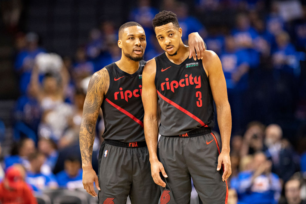 CJ McCollum (right) chose resigning with the Trail Blazers and playing alongside Damian Lillard instead of testing free agency.