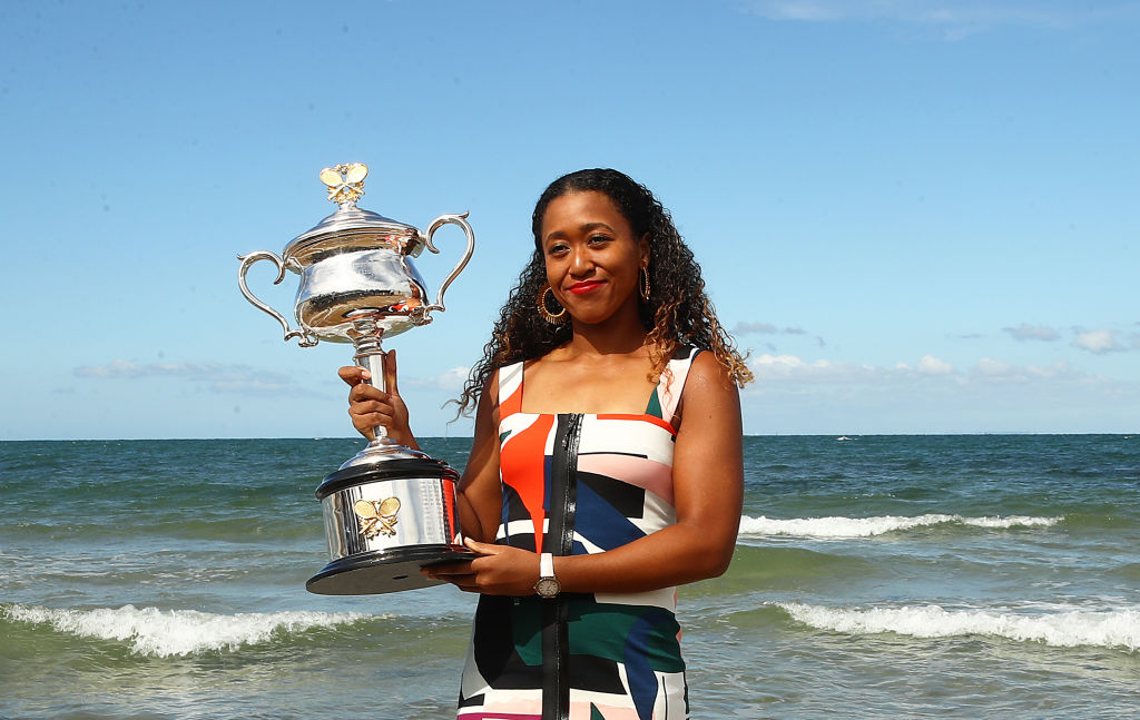 Tennis player Naomi Osaka poses at the beach with the Daphne Akhurts Memorial Cup