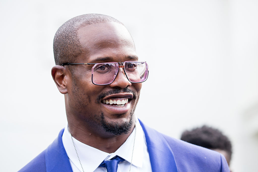 Close up of Von Miller smiling and wearing a blue suit