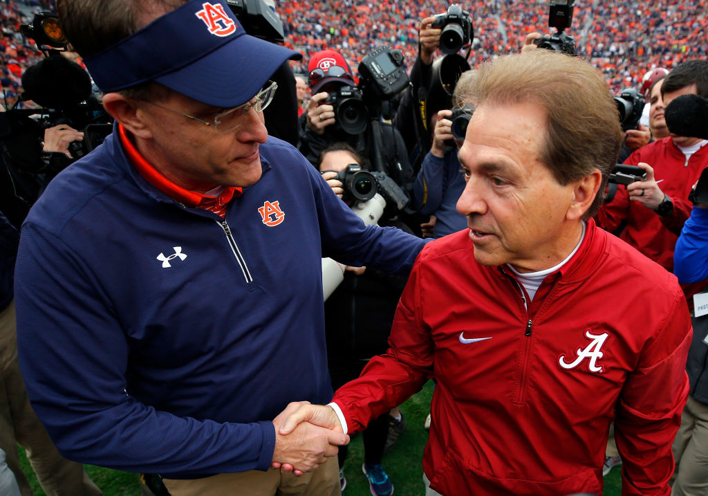 Auburn coach Gus Malzahn (left) took a verbal jab at Nick Saban (right) and in-state rival Alabama.