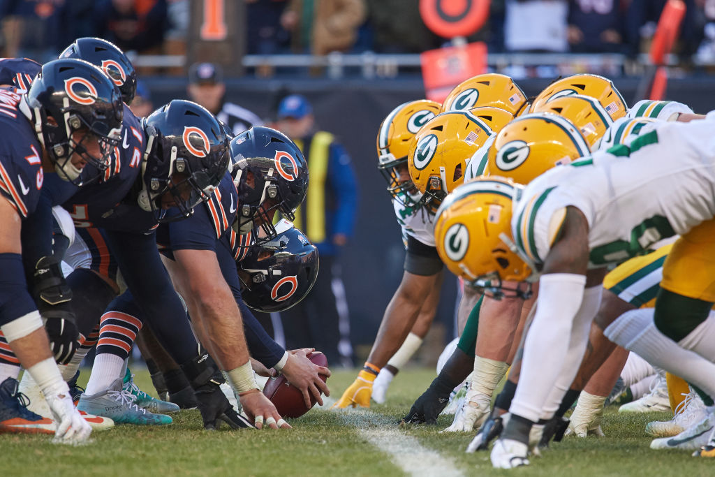 Chicago Bears vs the Green Bay packers line up on the field to start a play