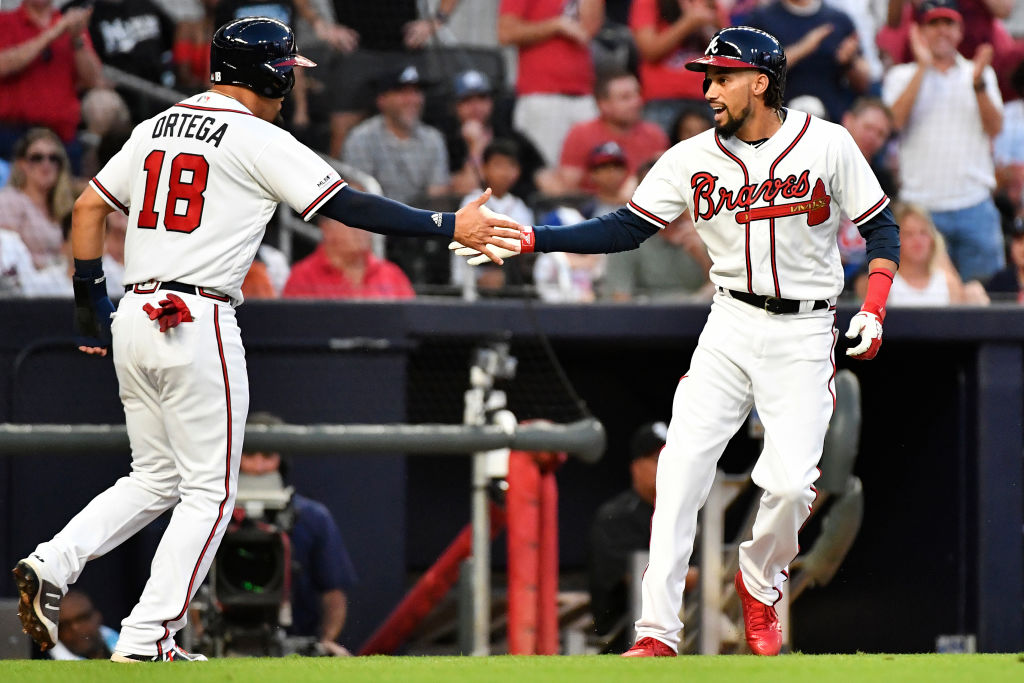 Adding Billy Hamilton (right) might be the key move to boost the Braves' postseason chances.