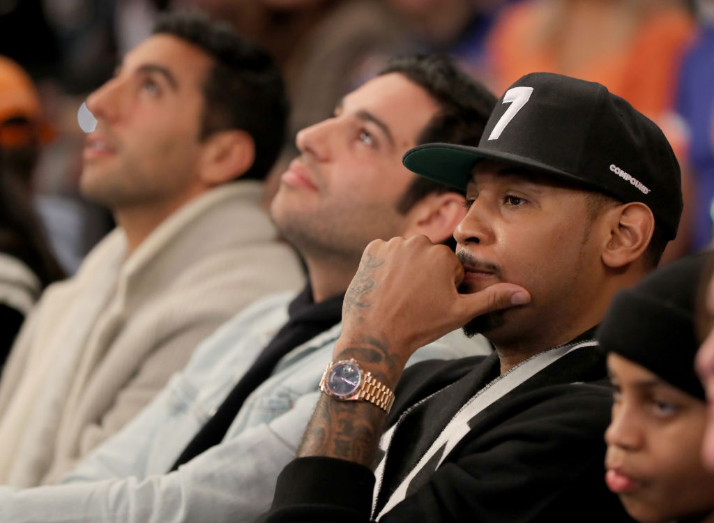 Carmelo Anthony sitting courtside at a Knicks' game