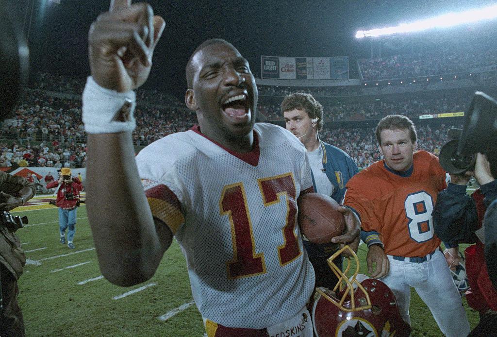 Redskins' quarterback Doug Williams celebrating a Super Bowl
