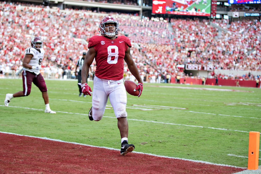 Josh Jacobs finishing up a touchdown run at Alabama