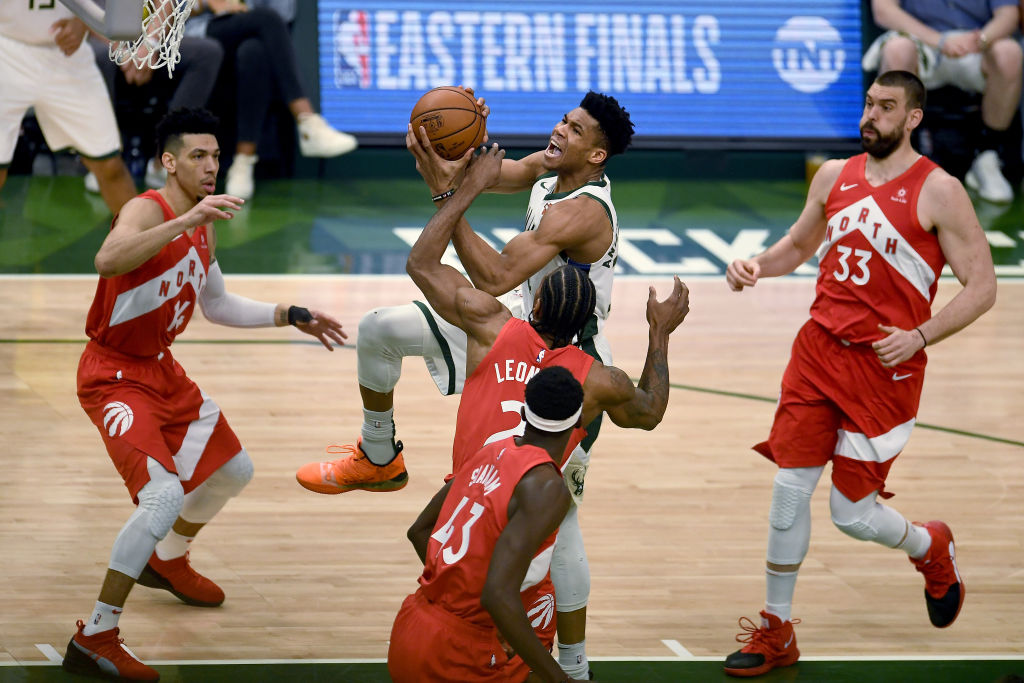 Giannis Antetokounmpo being swarmed by the Toronto Raptors