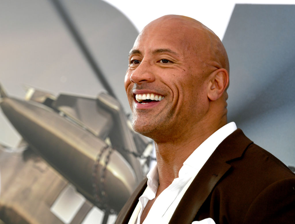 Dwayne Johnson arrives at the premiere of Universal Pictures