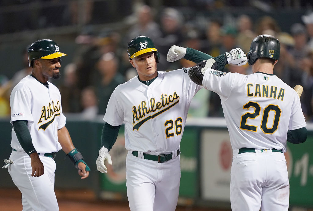 Matt Chapman celebrates with his teammates after hitting a home run
