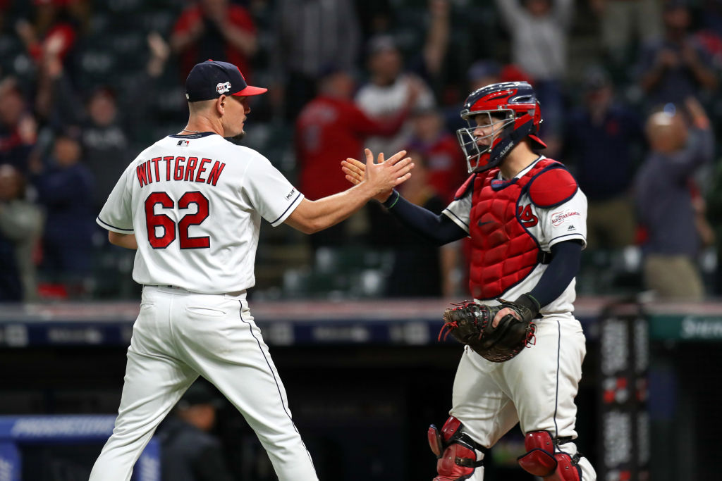 Cleveland Indians pitcher Nick Wittgren (62) is congratulated