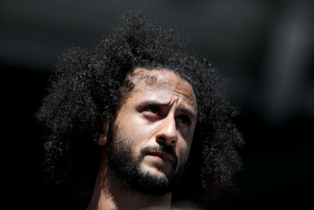 Colin Kaepernick watches a Women's Singles second round match