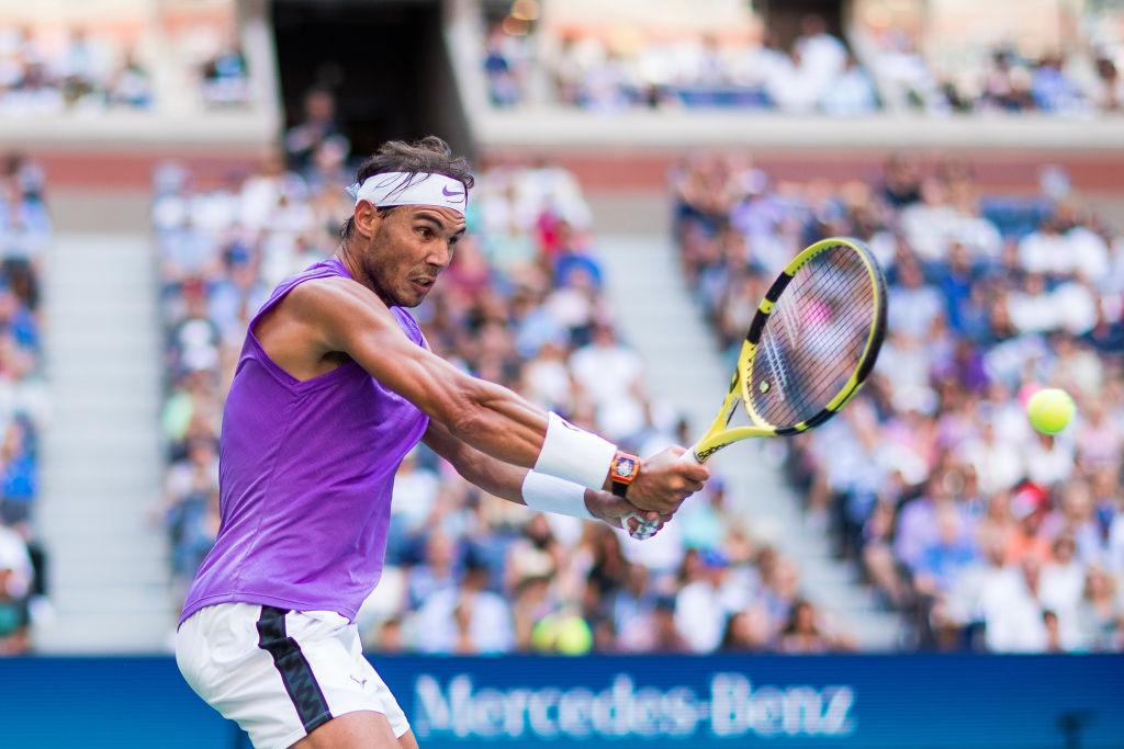 Rafael Nadal of Spain returns a shot against Hyeon Chung