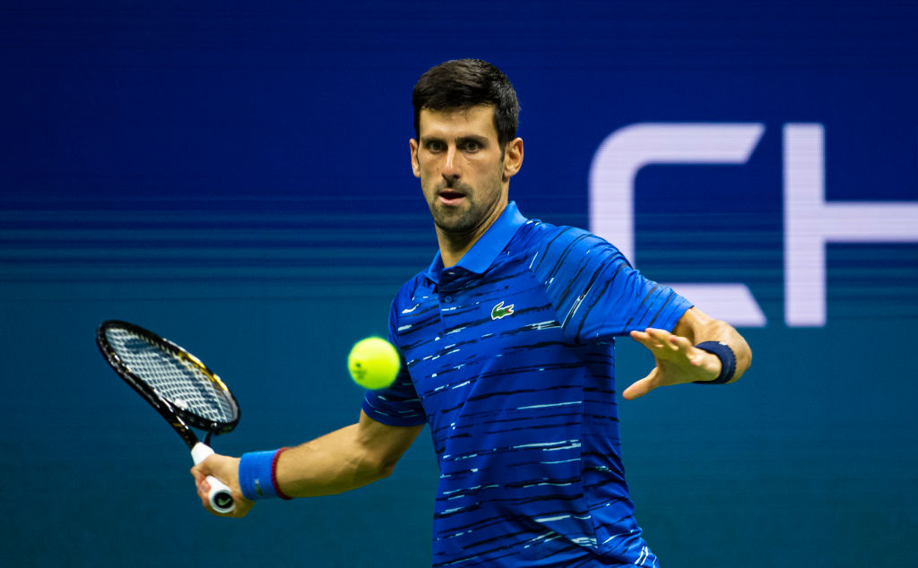 Novak Djokovic of Serbia hits a forehand