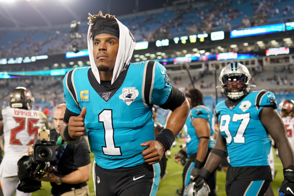 Cam Newton leaves the field after a disappointing loss to Tampa Bay