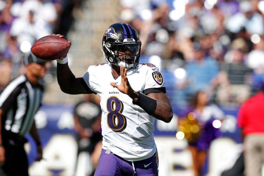 Quarterback Lamar Jackson #8 of the Baltimore Ravens throws the ball against the Arizona Cardinals