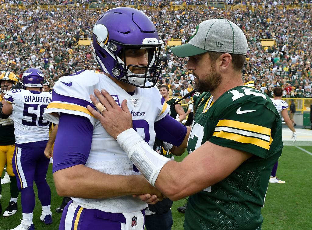 Kirk Cousins #8 and Aaron Rodgers #12 shake hands