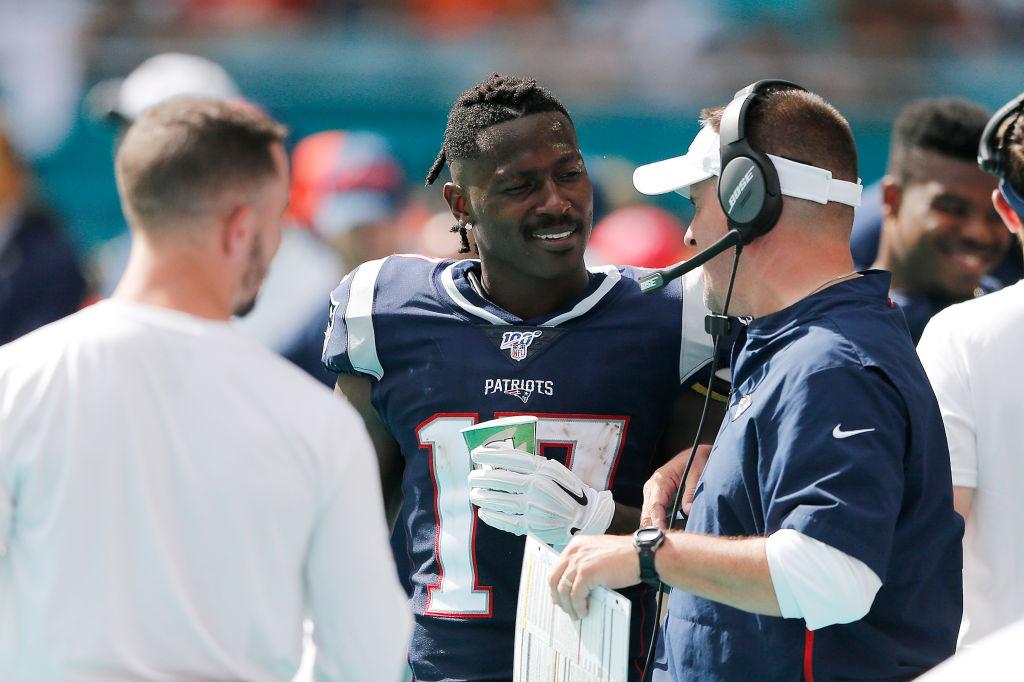 Antonio Brown #17 of the New England Patriots talks with offensive coordinator Josh McDaniels