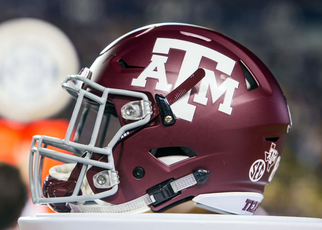 Texas A&M helmet rests on the sideline