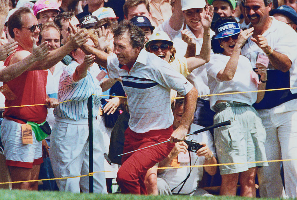 Hale Irwin high-fives fans after winning the 1990 U.S. Open