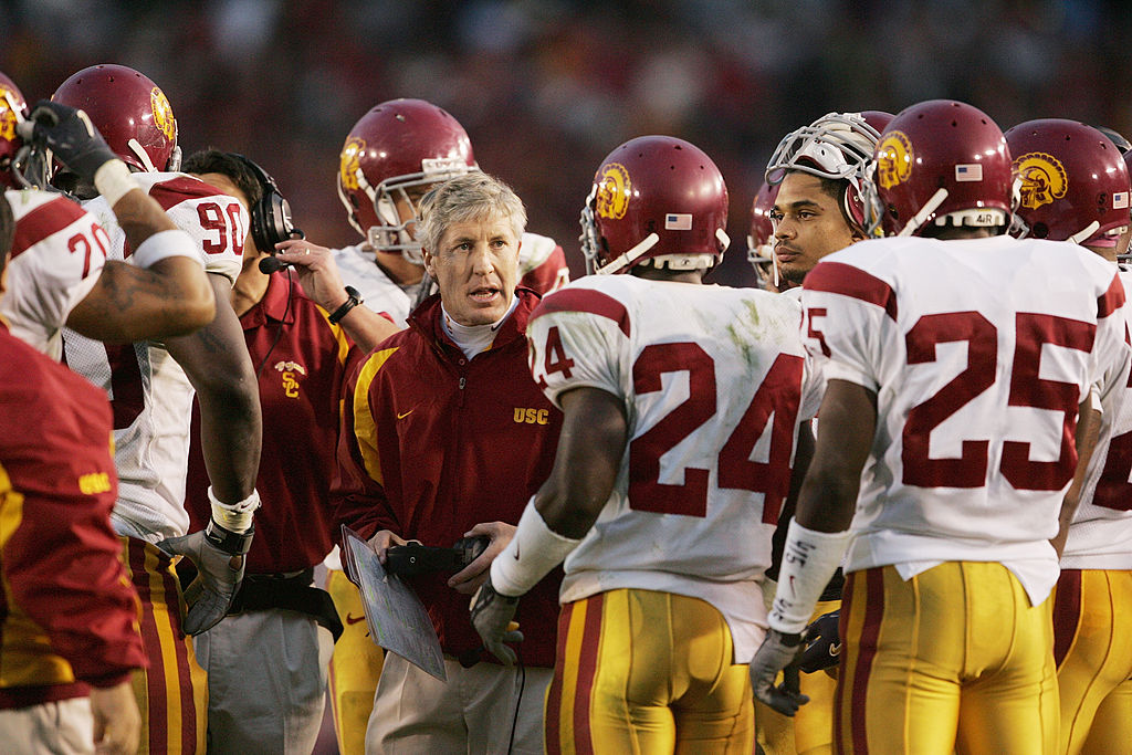 Head coach Pete Carroll of the USC Trojans talks to his team