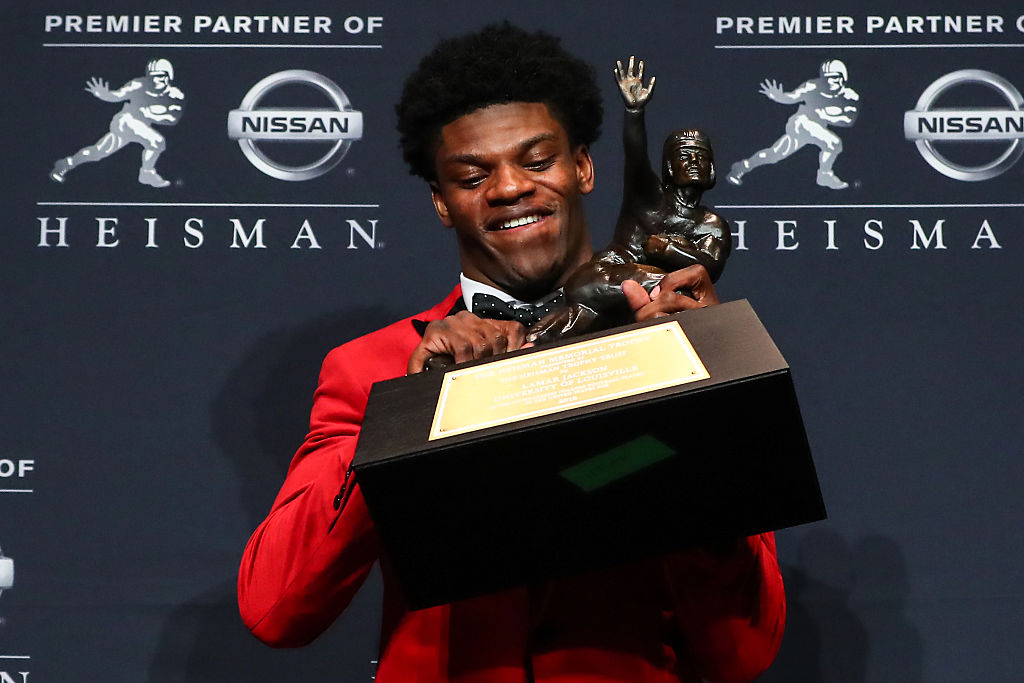 University of Louisville quarterback Lamar Jackson holds the 2016 Heisman Trophy