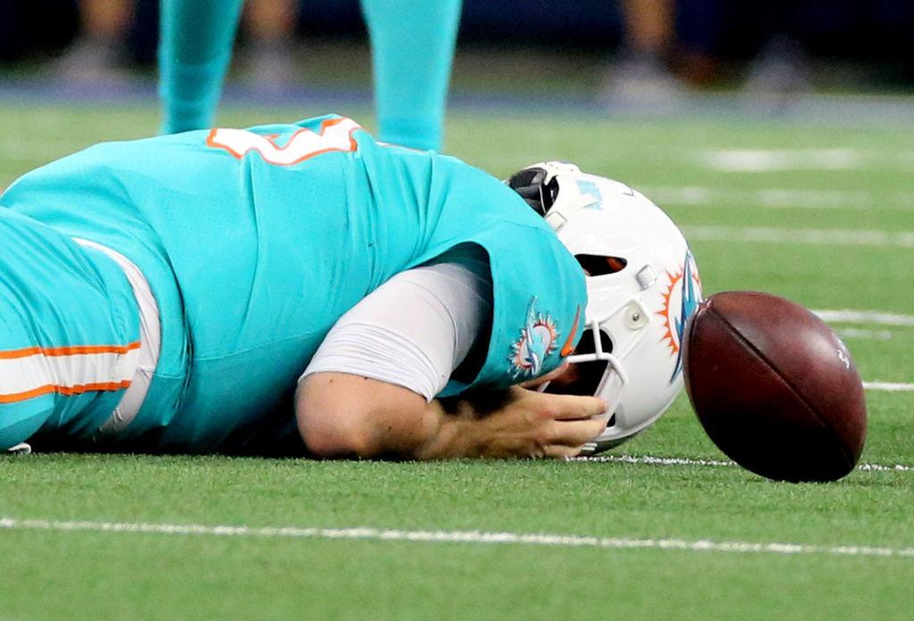 Miami Dolphins' quarterback Josh Rosen laying down after taking a sack.