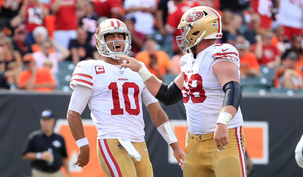 Jimmy Garoppolo and Mike Person enjoy the 49ers rout of the Bengals on Sept. 15, 2019.
