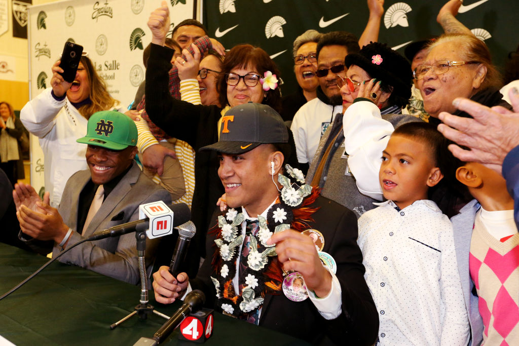 High school football players commit to their college football programs of choice during National Signing Day in 2019