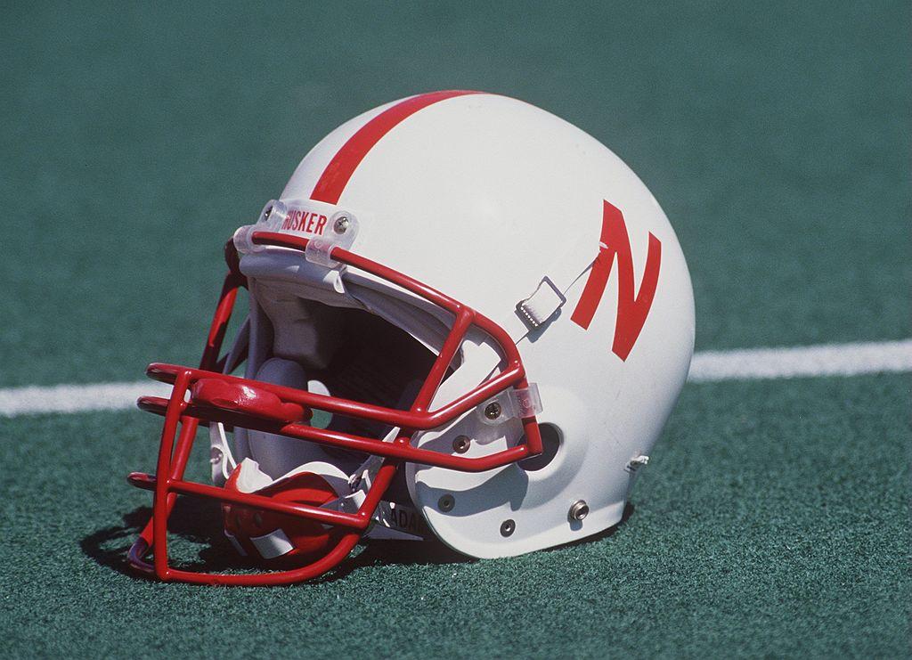 A Nebraska football helmet sitting on the field