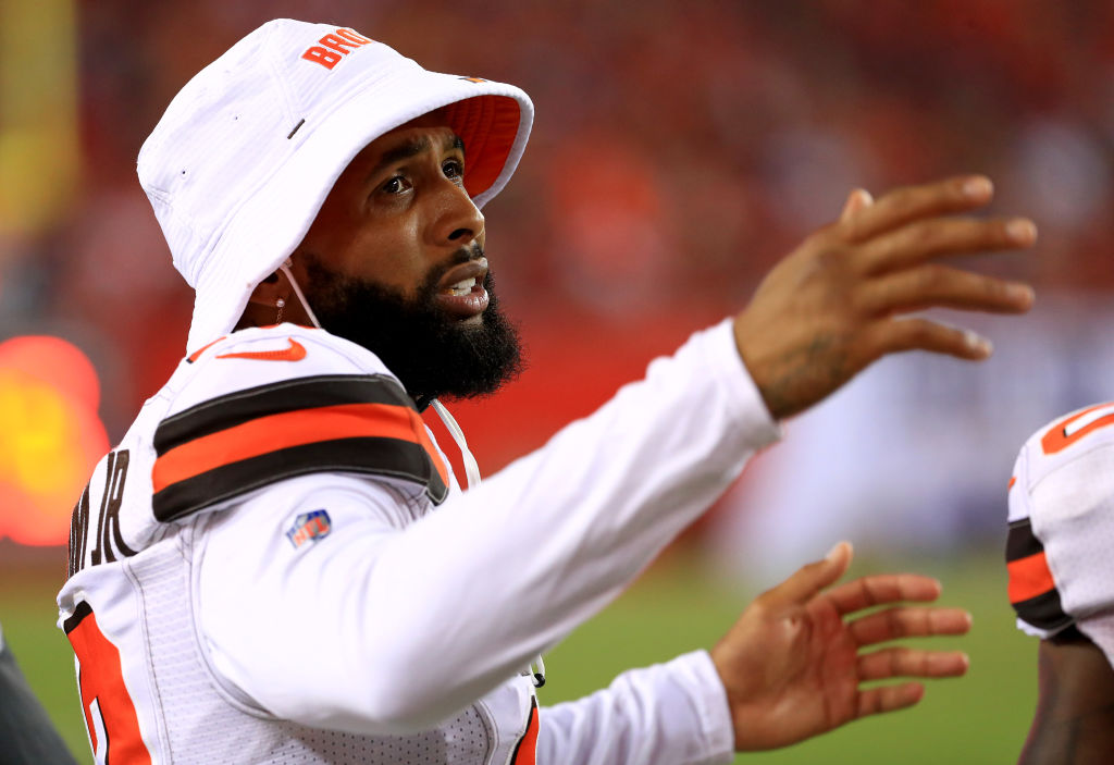 Odell Beckham Jr wears a Cleveland Browns bucket hat and new jersey