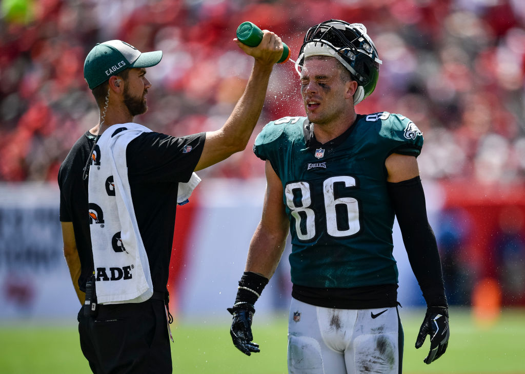 A water boy hoses down Zach Ertz