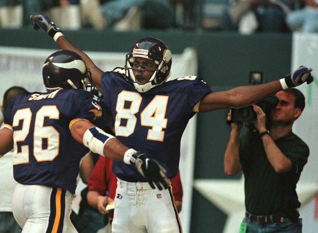Randy Moss celebrates a touchdown with a Minnesota Vikings teammate