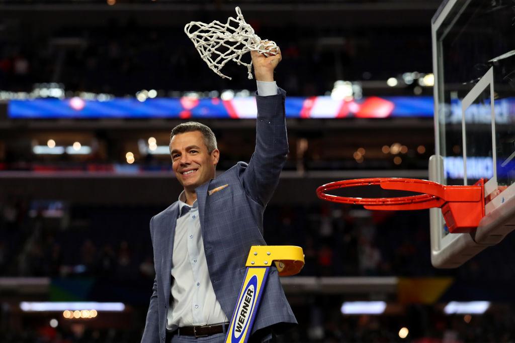 Virginia basketball coach Tony Bennett cutting down the basketball net.
