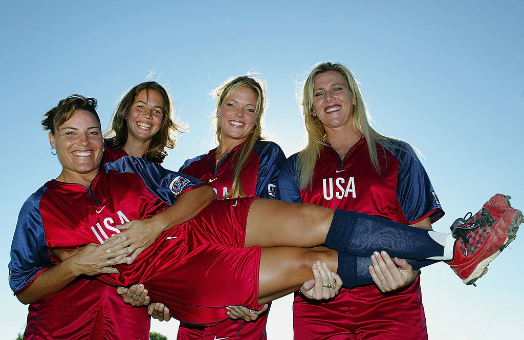 The starting pitchers for the USA Women's Softball Team at the Greece Olympics, Lisa Fernandez, Cat Osterman, Jennie Finch, and Lori Harrigan, pose for a picture