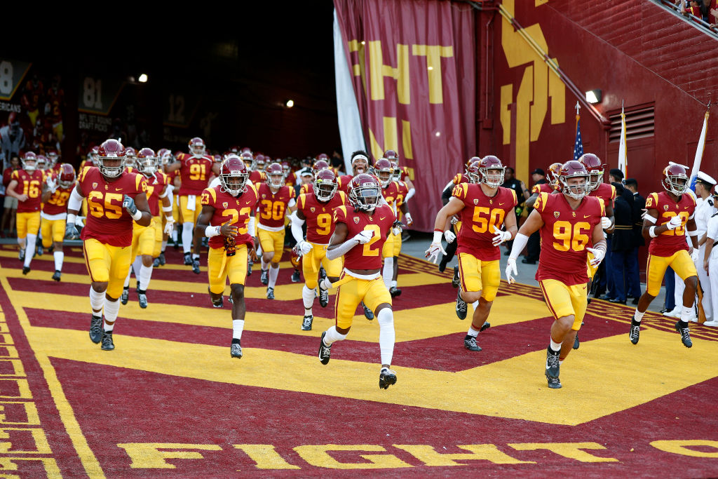 The USC Trojans running onto the field before their upset win over the Utah Utes