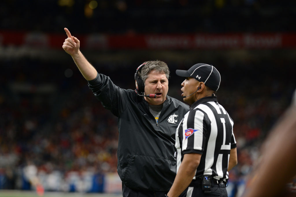 Washington State Cougars head coach Mike Leach yells at an official