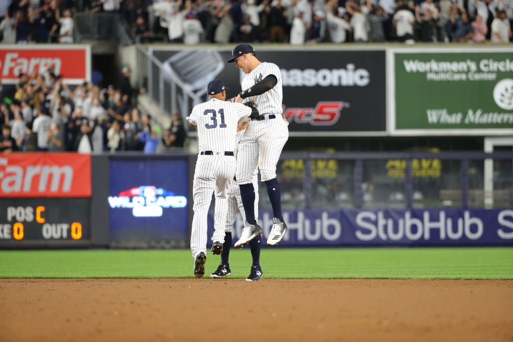 Aaron Hicks and Aaron Judge of the New York Yankees celebrate after the Yankees won the American League Wild Card game in 2018