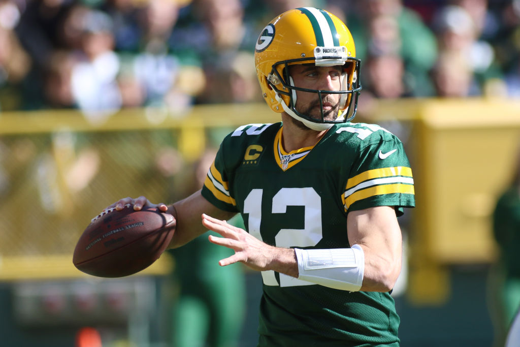 Packers' quarterback Aaron Rodgers drops back for a pass.