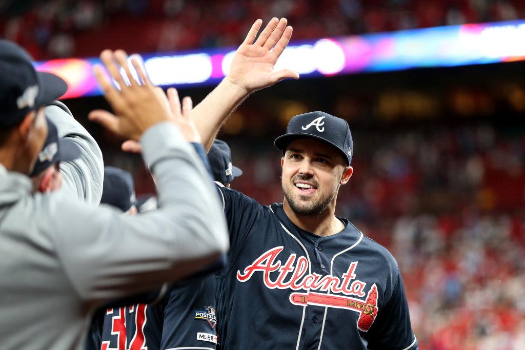 Adam Duvall #23 of the Atlanta Braves celebrates with his teammates
