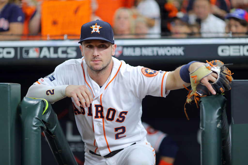Alex Bregman of the Houston Astros watches the game from the dugout.
