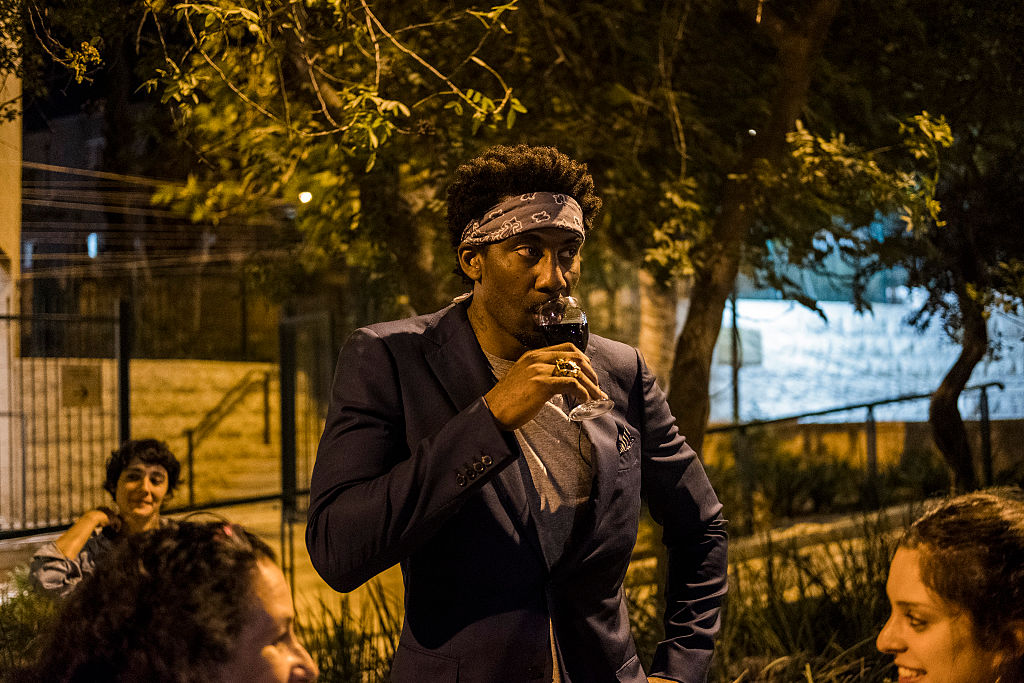 Amar'e Stoudemire drinks wine during a contemporary art exhibition