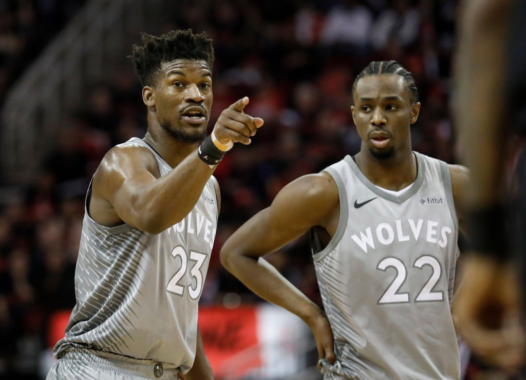 Andrew Wiggins looks on as Jimmy Butler points and yells.