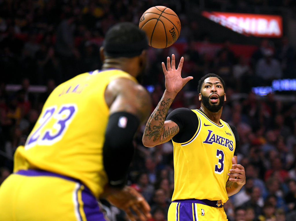 LeBron James passes the ball to his new Lakers teammate Anthony Davis.
