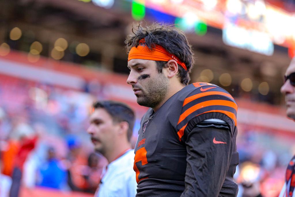 Browns' quarterback Baker Mayfield walks of the field looking sad.
