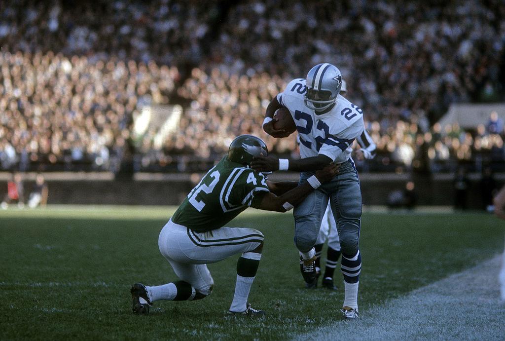 Cowboys' Bob Hayes runs passed a defender.