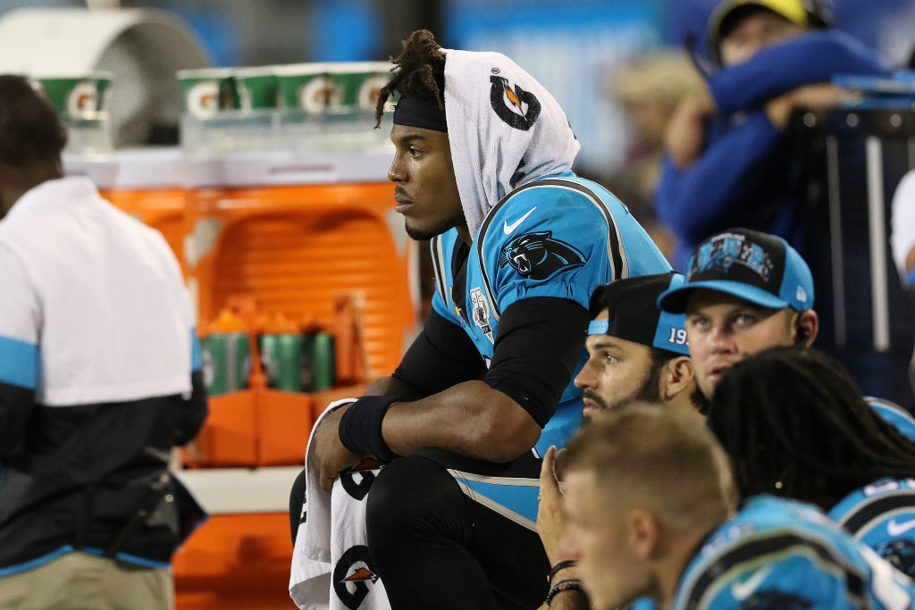 Cam Newton sits on the sidelines in disbelief